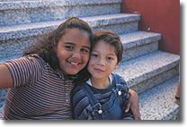 image of two children on steps